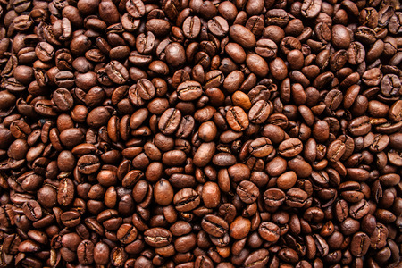 Closeup photo of Coffee Beans texture. Coffee background