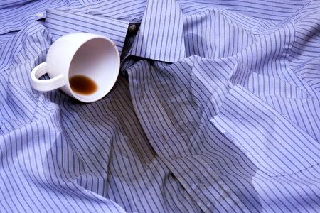 coffee spill: Close up photo of Coffee Spilled On A Shirt