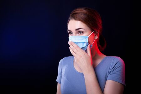 Beauty Woman Holding  Medical Mask With Her Arm Stok Fotoğraf