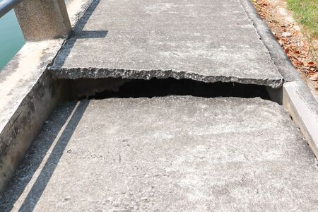 Concrete road with cracks With the shadow of the sunlight