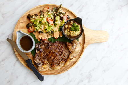 t bone steak: T Bone Steak, top view Stock Photo