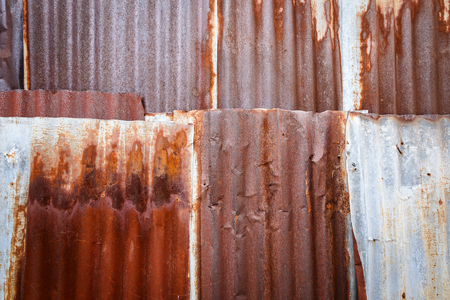 Old rusty zinc wall for textured background, Tin roof abstract rusty