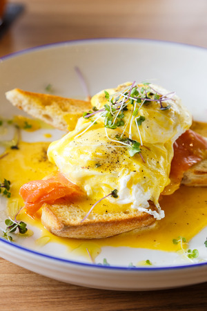 benedict: Closeup of eggs benedict with smoked salmon and toasted ciabatta bread Stock Photo