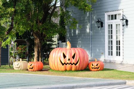 large doors: The big pumpkin in Halloween festival. Stock Photo
