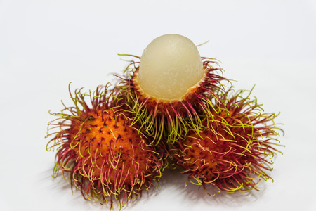 acidic: Rambutan thai fruits a red, plum-sized tropical fruit with soft spines and a slightly acidic taste. Stock Photo