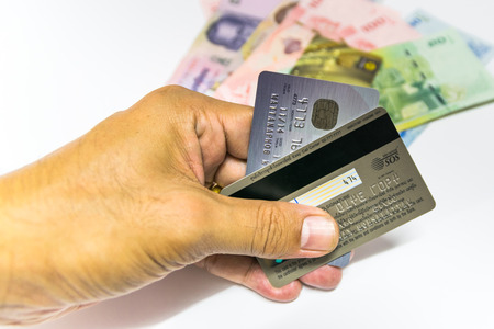 allowing: A small plastic card issued by a bank, business, etc., allowing the holder to purchase goods or services on credit.