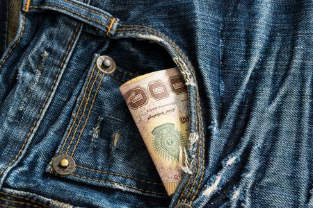 cotton  jeans: Thai moneys in blue jean pocket.