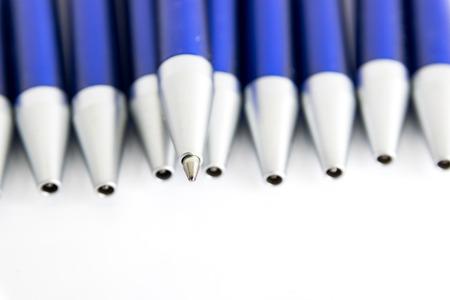 Blue shaft blue ballpoint pens on white background.