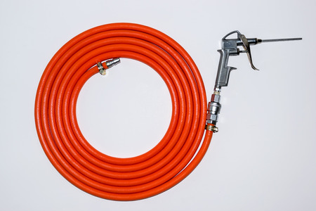 compressed air hose: Orange air hose isolated on white background. Stock Photo