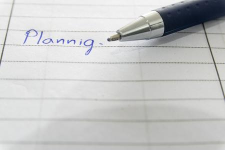 ballpen: Blue ballpen writed planning on the book. Stock Photo