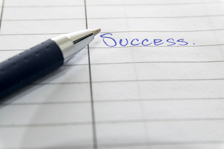 ballpen: Blue ballpen writed success on the book. Stock Photo