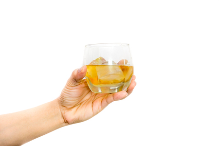 ices: Womans hand holding a glass of wine with ices.