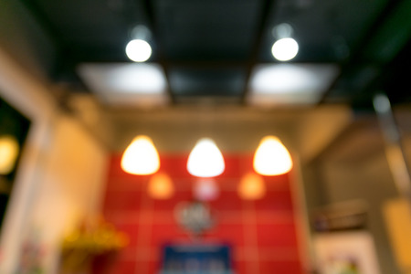 defocussed: Blurred bokeh lights background in the office.