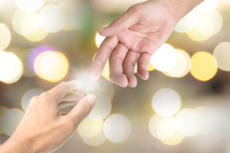 hands of light: The symbol used to show each other a helping hand. Stock Photo