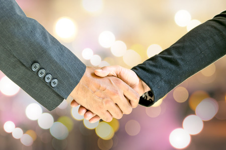 shaking: Business men and women shaking hands with each other to work together. Stock Photo