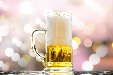 Beer golden white bubbles in the glass on beautiful background for Christmas and new year days.