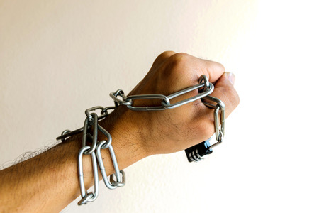 constricted: The chain lock was at the hands of men.