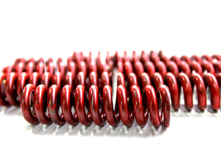 spiralling: Group of iron red springs isolated on white background.