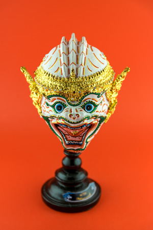 actors: Thailand actors mask isolated on red background. Stock Photo