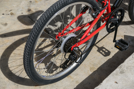 pedals: A vehicle composed of two wheels held in a frame one behind the other, propelled by pedals and steered with handlebars attached to the front wheel. Stock Photo