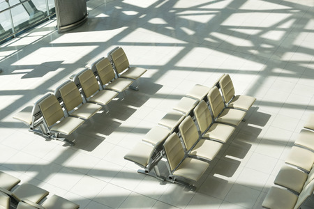 elbow chair: Empty chair waiting for passengers boarding at airports.