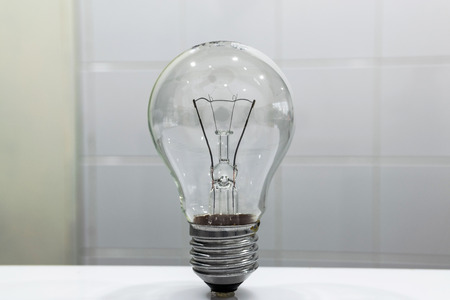 emitting: Incandescent lamp emitting light as a result of being heated.
