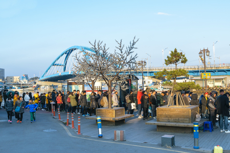 other side of: Seoul,Korea-January 2,2016:Visitors lined up to take a ferry to the other side of the river at fishing village in Korea.