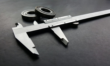 sliding caliper: Vernier is a measure of the jobs and the industry is measured in centimeters and inches. Stock Photo