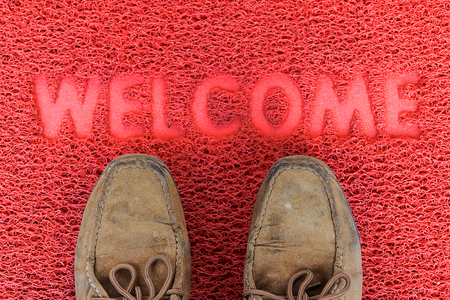 foot ware: Welcome door capet  with foot ware on it. Stock Photo