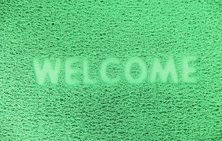 doormat: Welcome plastic  doormat texture background. Stock Photo