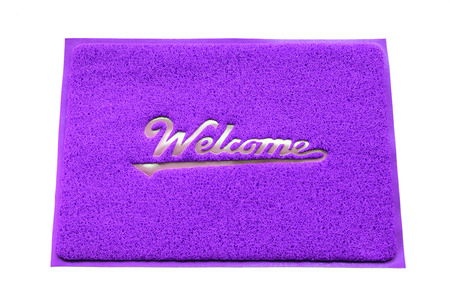 doormat: Welcome doormat isolated on white background. Stock Photo