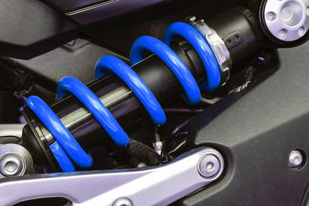 vibrations: A device for absorbing jolts and vibrations, especially on a motor vehicle.