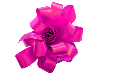 Gift box tied with a pink ribbon bow isolated on white background.