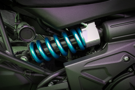 vibrations: Motorcycle shock absorbers a device for absorbing jolts and vibrations, especially on a motor vehicle.