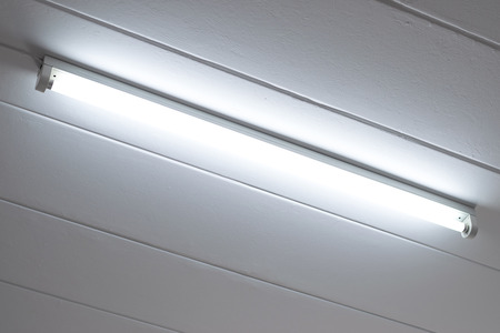 Fluorescent light bulb on the ceiling in the bedroom.