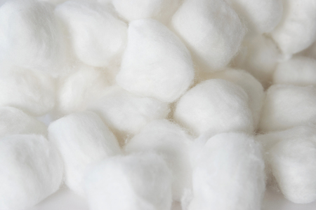 raw cotton: Cotton balls of a kind originally made from raw cotton, used for cleansing wounds, removing cosmetics. Stock Photo