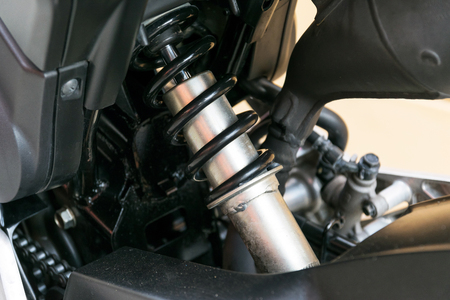 vibrations: Motorcycle shock absorber a device for absorbing jolts and vibrations, especially on a motor vehicle.