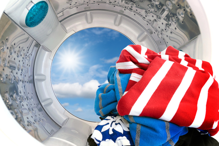 Closeup of clothes inside the washing machine. Stock Photo