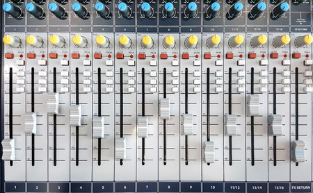 fader: Closeup of controls for the audio mixer.