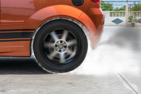rotational: The smoke caused by the friction of tires on the road surface when the wheel rotational speeds.