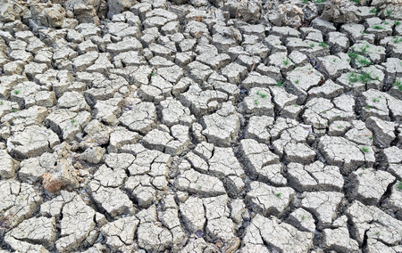split up: Cracked earth background texture,Cracked soil because water wells dry up. Stock Photo
