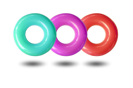 inner tube: Group of colorful  swim rings was derived from the inner tube, the inner, enclosed, inflatable part of older vehicle tires. Stock Photo
