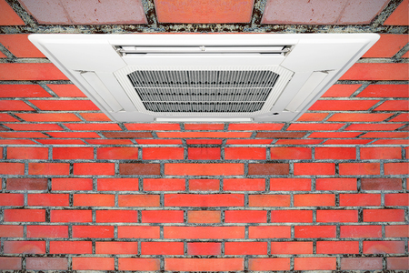 expel: Built-in air conditioner for home and office embedded on the ceiling made of red brick.