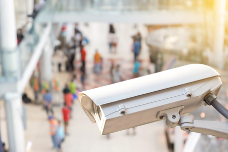 closed circuit television: CCTV or surveillance camera recording inside the airport terminal to the various internal security. Stock Photo