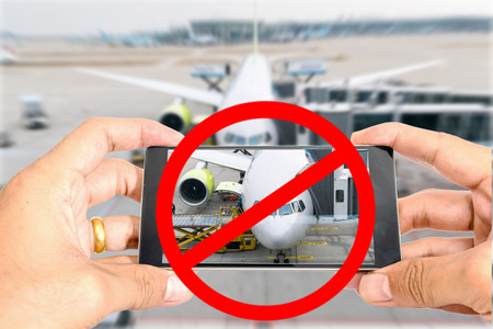 Do not use smart phones to take pictures of the airplane in the airport.