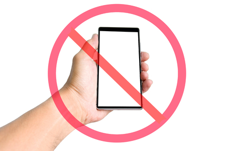 hand holding smart phone: Hand holding smart phone with do not use smart phone sign isolated on white background.