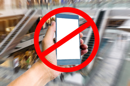 use: Do not use the smart phone in the building sign. Stock Photo