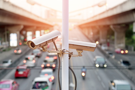 Closeup of traffic security camera surveillance (CCTV) on the road in the big city.