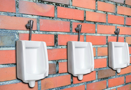 chamber pot: Urinal or chamber pot for men on the brick wall in the men's toilet.