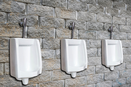 urinal: Urinal or chamber pot for men on the brick wall in the men�s toilet. Stock Photo